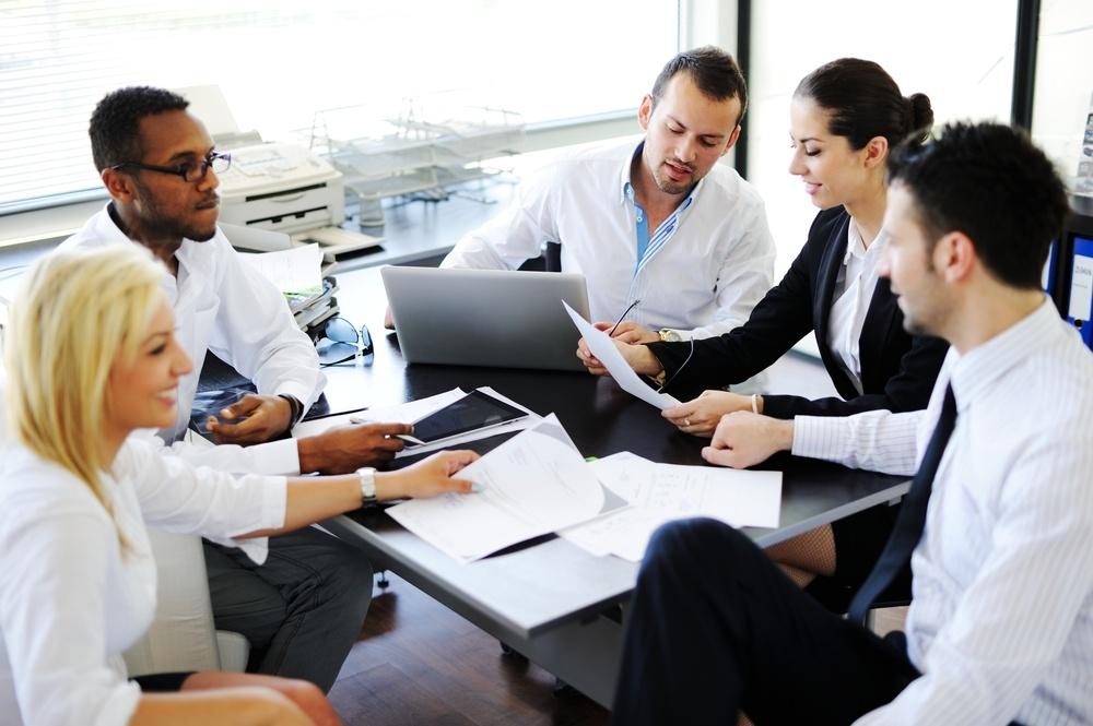 Business people working in office having meeting.jpeg