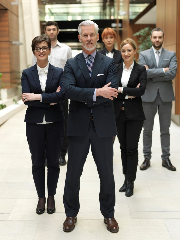 senior businessman with his team at office. business people group.jpeg